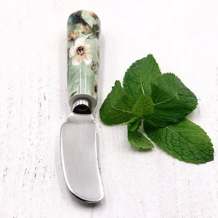 Green flower and humming bird spreader