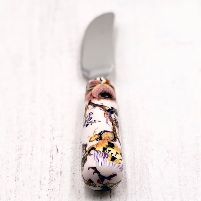 White, with pink & yellow flowers, spreader and butter knife